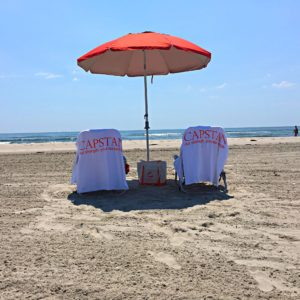 Beach image featuring Capstan bag and beach towels